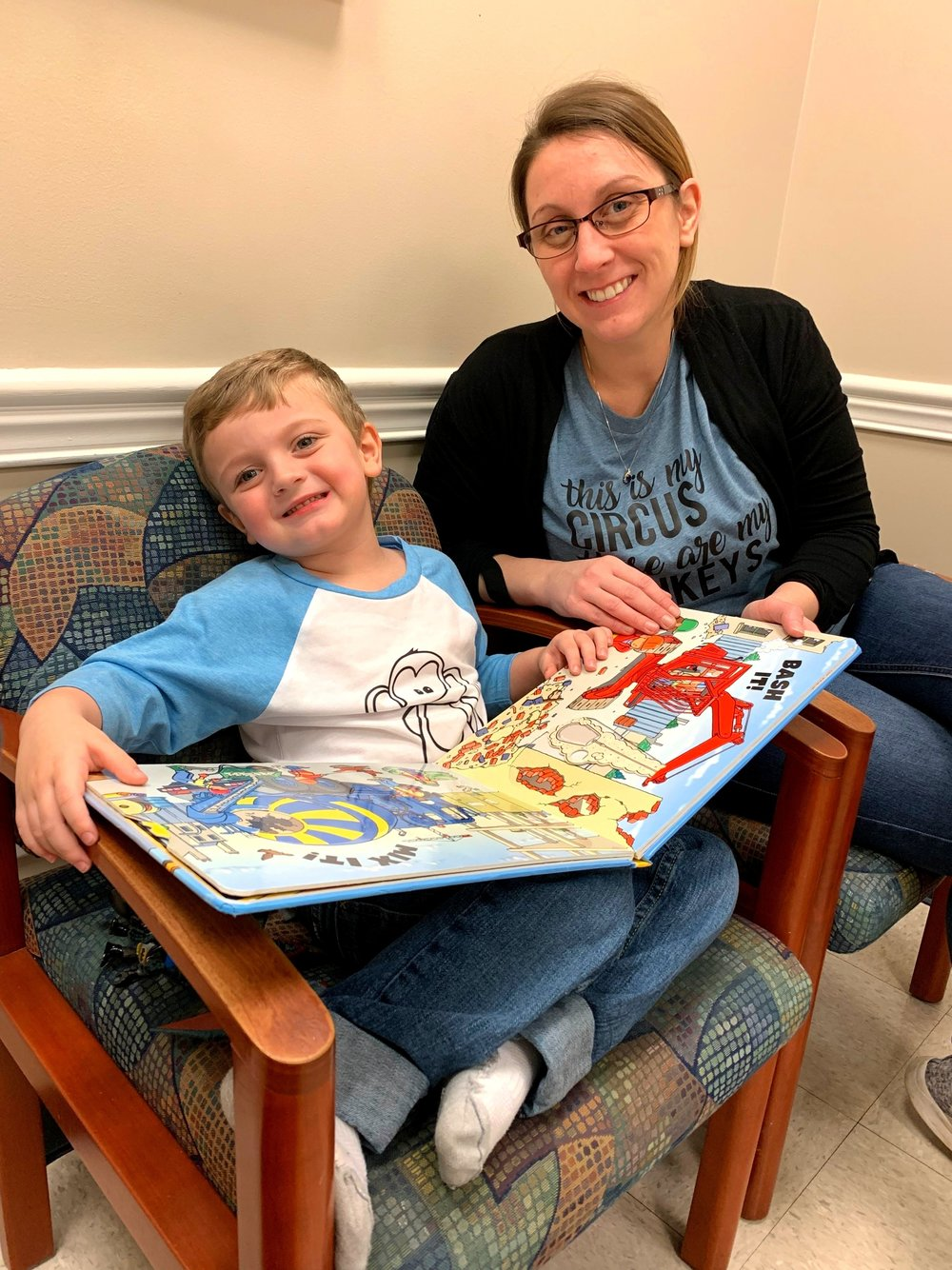 Sam and his mom reading a book during his office visit.