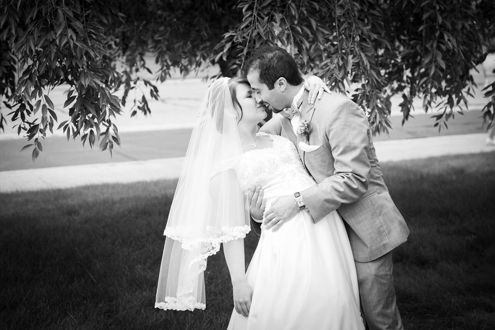 Spring Lake-Presbyterian Church-Bride-Groom-Dip-Kiss-Wedding-Lakeshore-Grand Haven-Michigan-West Michigan-Muskegon-Black and White.jpg