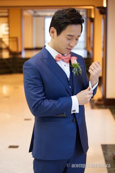 21-groom-fixing-cufflink
