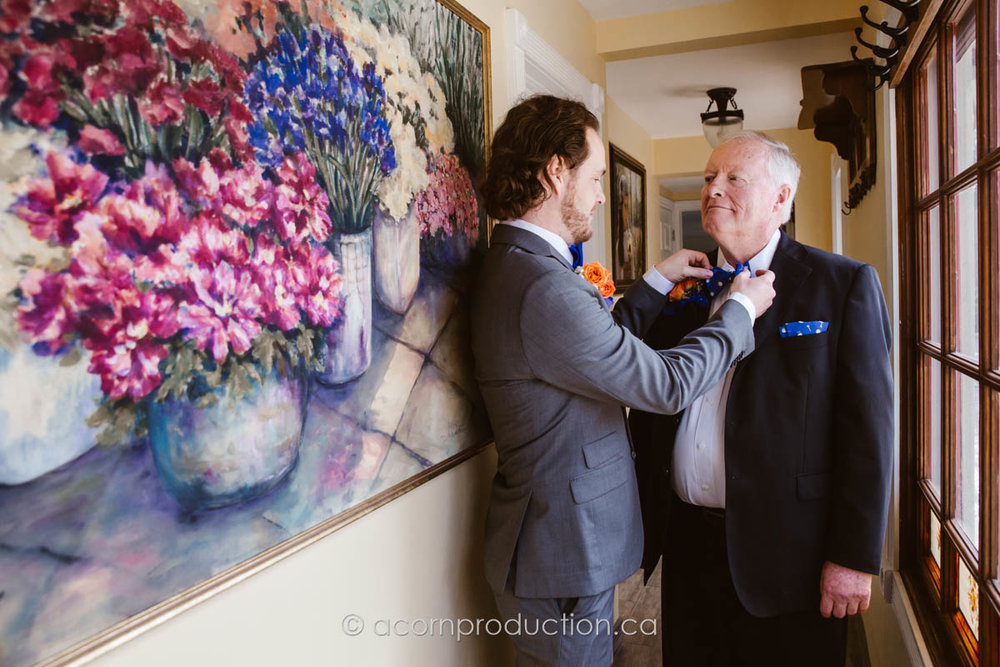 groom-fixing-bow-tie-father
