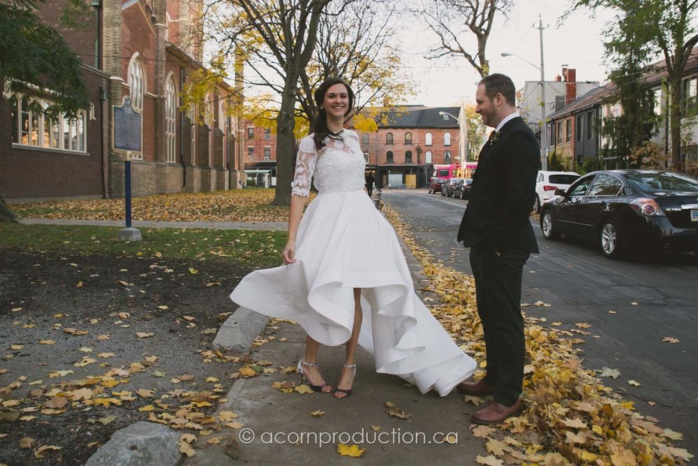 bride shows off her dress to the groom during first look