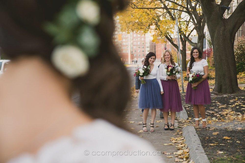 happy bridesmaid looking at the bride
