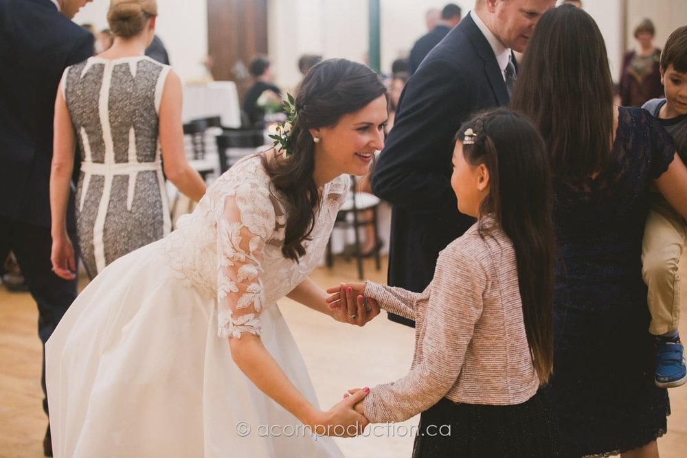 bride dancing with young girl inside enoch turner schoolhouse