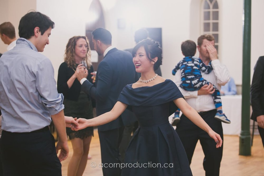 wedding guest dancing with partner inside enoch turner schoolhouse