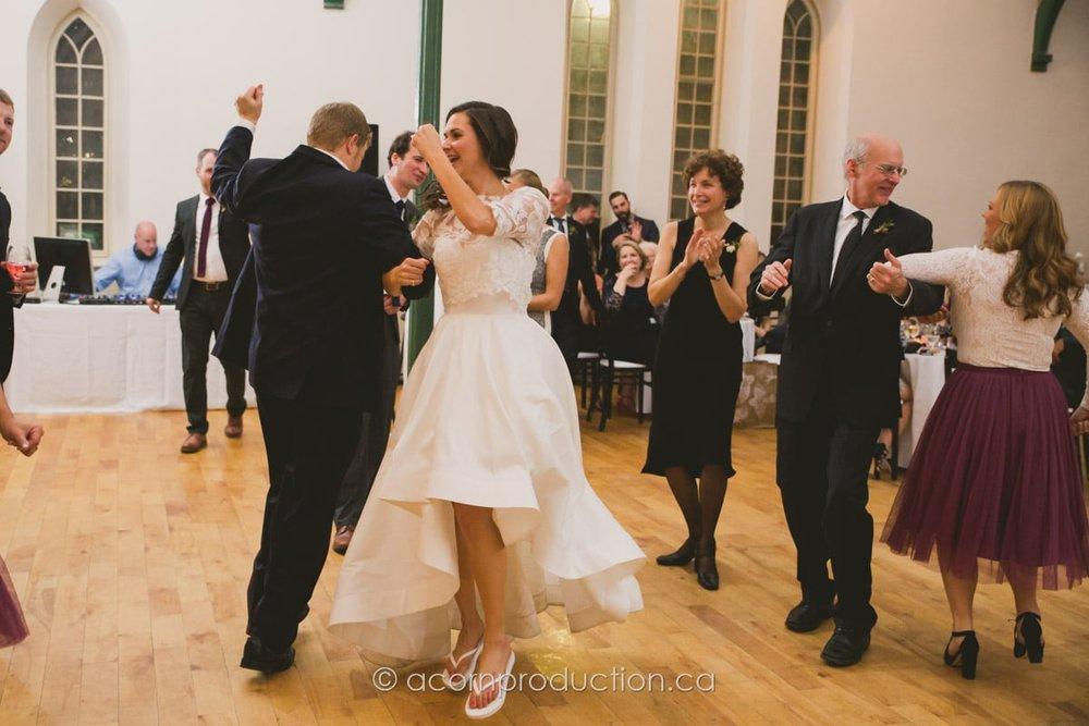 wedding guests dancing inside enoch turner schoolhouse