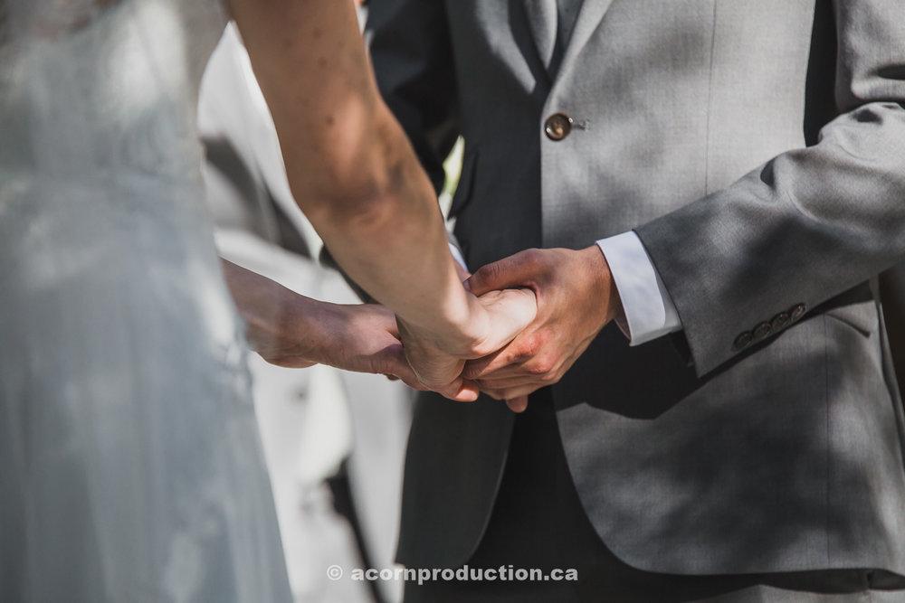 toronto-granite-brewery-wedding-cermony-holding-hands.jpg