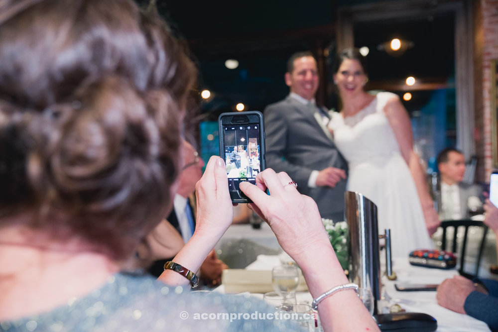 toronto-granite-brewery-wedding-guest-taking-photo-using-cell-phone-by-acornproduction.ca-100.jpg