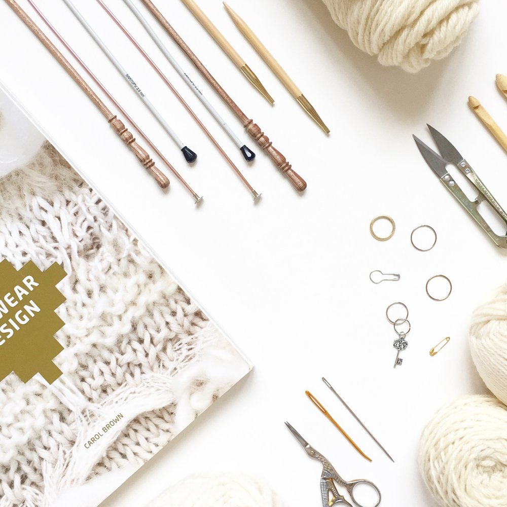 Knitting supplies: yarn, needles, books, notions, notebooks