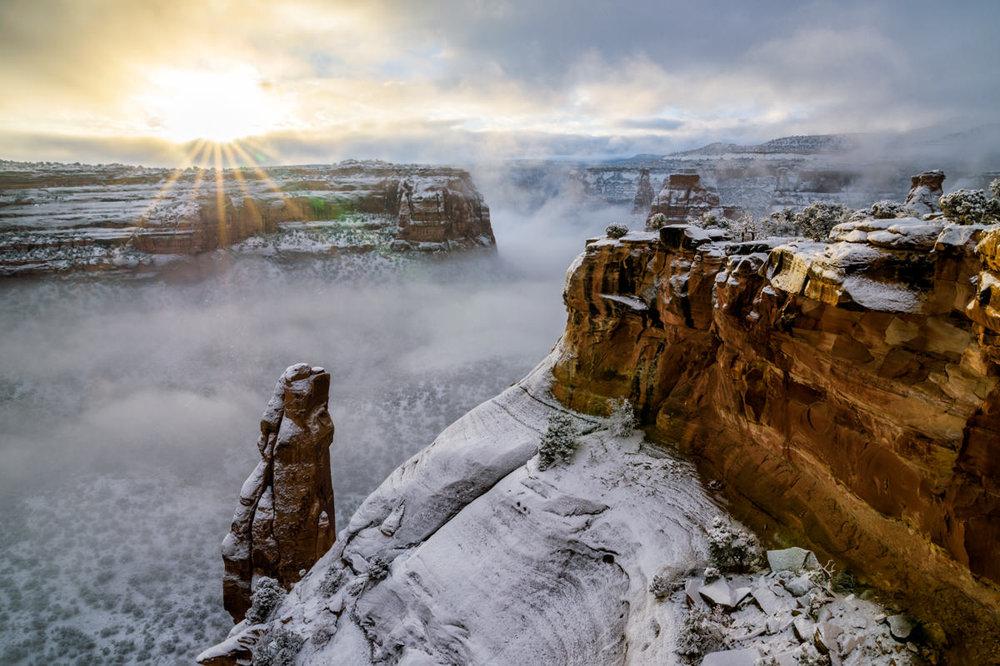 Foggy Sunrise Over Monument Canyon