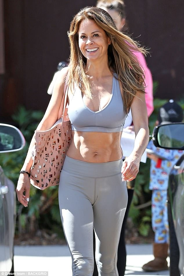 Brooke Burke, actress, model, and TV personality, caught wearing one of your bags!