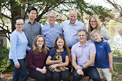 Tom's Family - Hoch is married to retired General Mills Executive Mark Addicks.  They have a son, John who is a high school senior.   They also have a daughter, Chris Oster, a public school teacher, who lives with her husband and three children in Chaska.