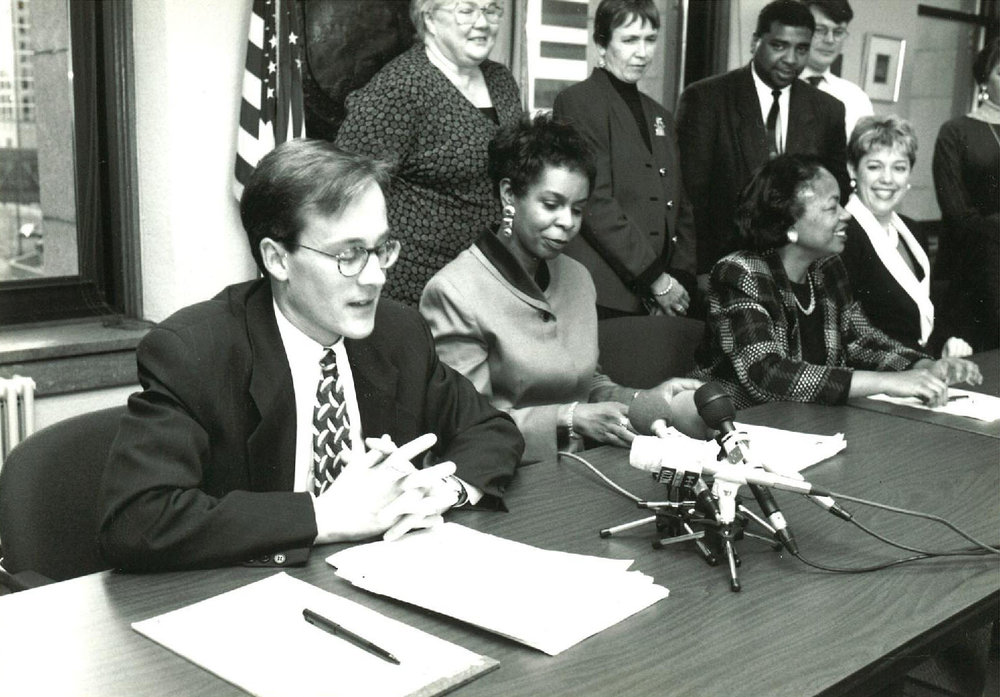 Hollman Consent Decree announcement, 1995. Left to right: Me, MPHA Exective Director Cora McCorvey, and Mayor Sharon Sayles Belton.