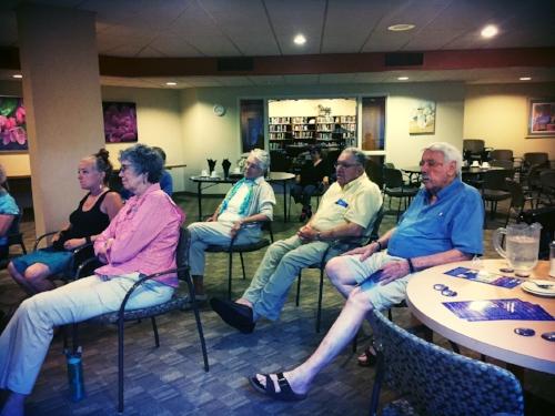 Voters listening to Tom speak at Kenwood Isles.