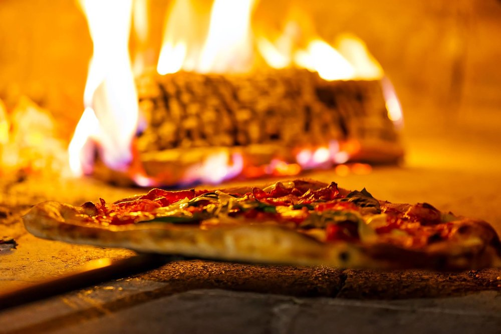Book Our Wood Fire Oven on Wheels! - Are you planning a celebration and need something different? We get it and we got it! Book Isola's mobile pizza oven and wow your guests with our award-winning Neapolitan-style pizza MADE TO ORDER!  RESERVE FOR YOUR EVENT TODAY!858-999-0107 | eat@isolapizzabar.com today!