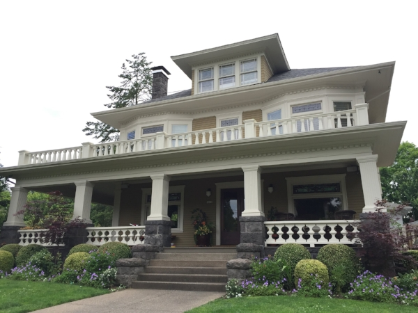 A Portland Foursquare home located in the Irvington neighborhood. It features some details not often found on craftsman homes, including dental molding and a balustrade.