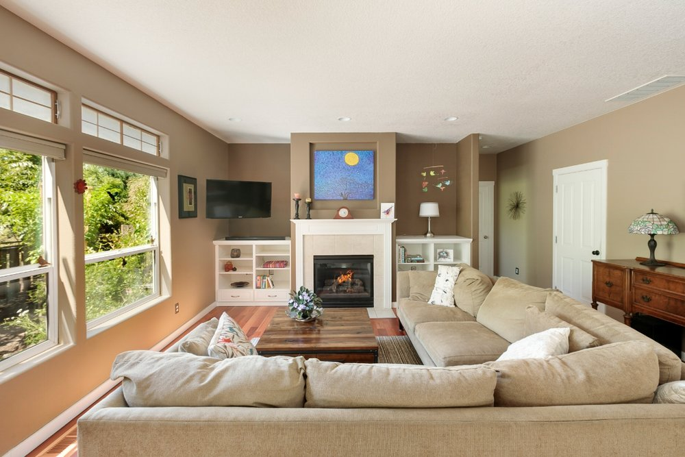 Custom built ins and a gas fireplace add extra character to the family room. And, did I mention the custom eucalyptus floors?