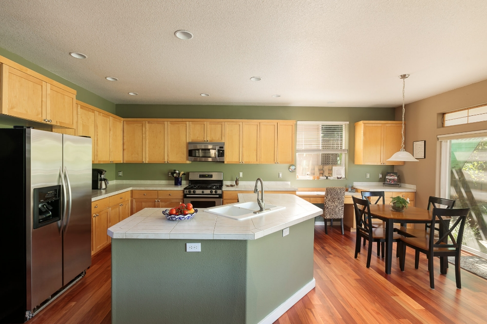 The large, open kitchen, island, and breakfast nook are just what the cook ordered.