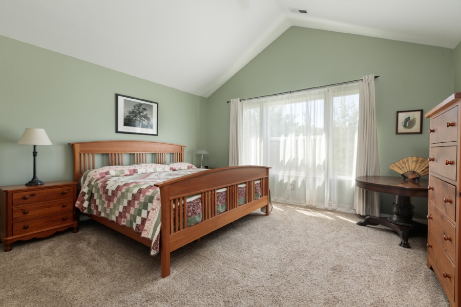 Upstairs you will find a spacious master suite with vaulted ceilings, view of the nature park and...