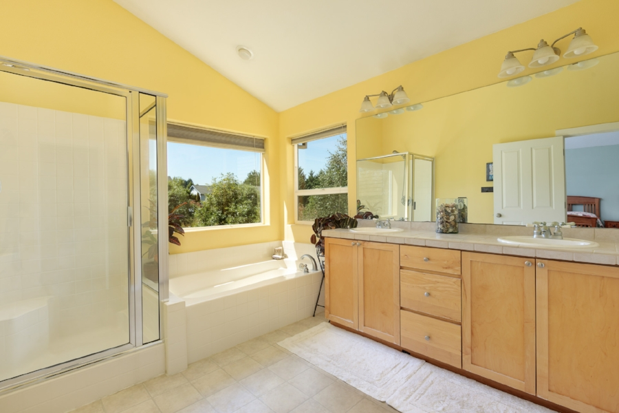 ... an en suite master bath with double vanity, soaking tub, shower, and walk-in closet.