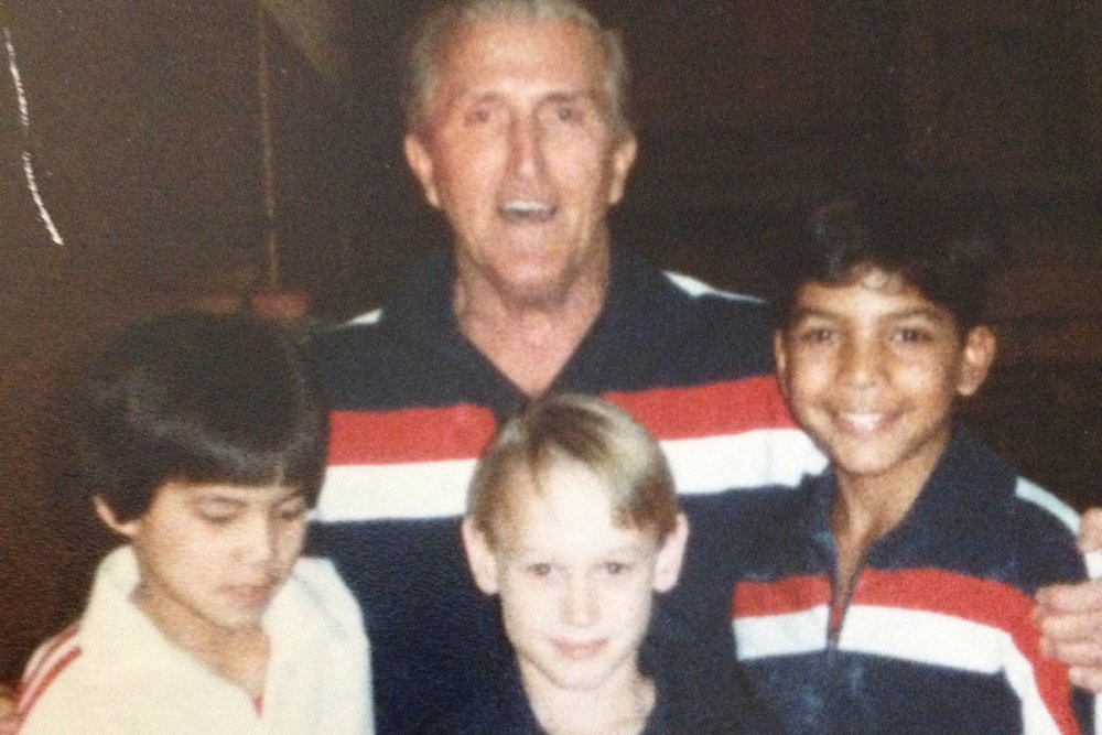 Far Right: Steve V. Rodriguez as a young gymnast with best in front, teammate and Coach Around 1982