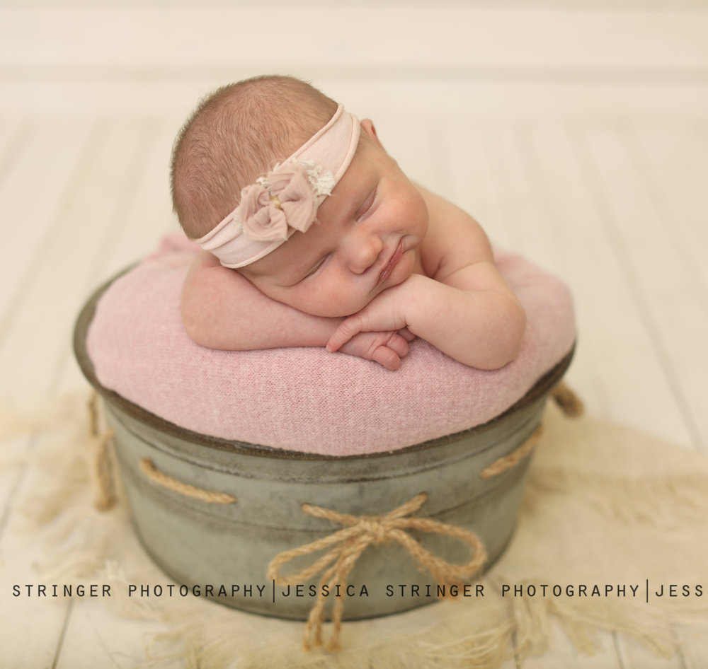 posed newborn images in studio webster rochester ny