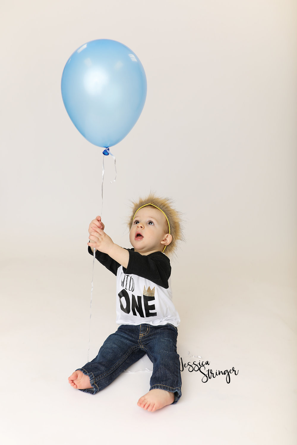 first birthday cake smash photo session rochester ny