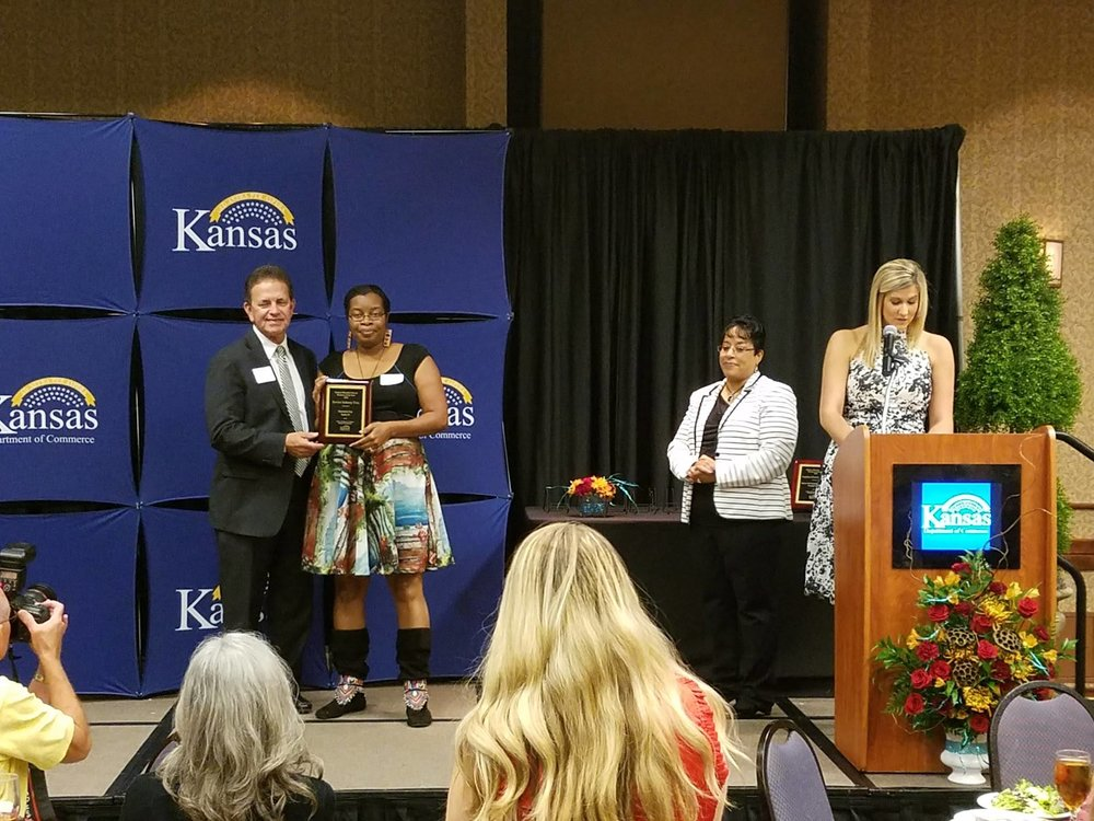 Our founder and CEO, Kia McClain receiving her Kansas Minority-Owned Business of the Year Award in Topeka, KS in late 2016.