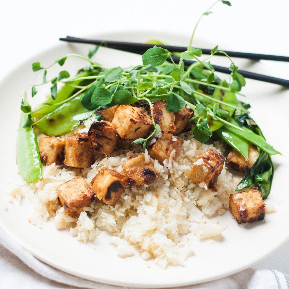 Crispy Peanut Tofu on Garlic Fried Caulifower Rice