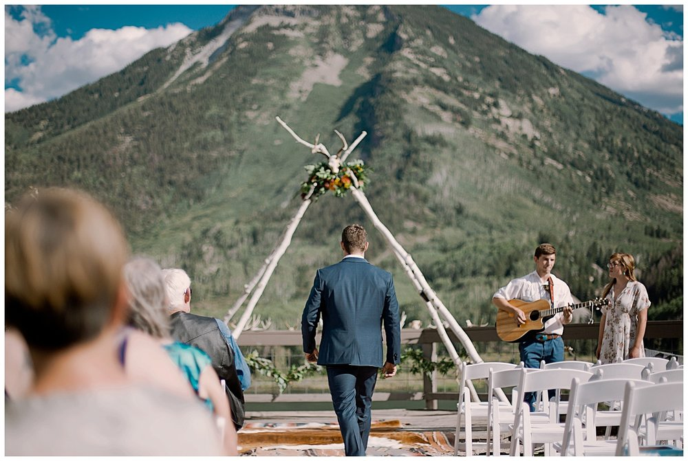 groom walking down the aisle, adventurous colorado wedding photographer, adventure wedding, marble lodge wedding, marble colorado wedding, outdoor colorado wedding ceremony