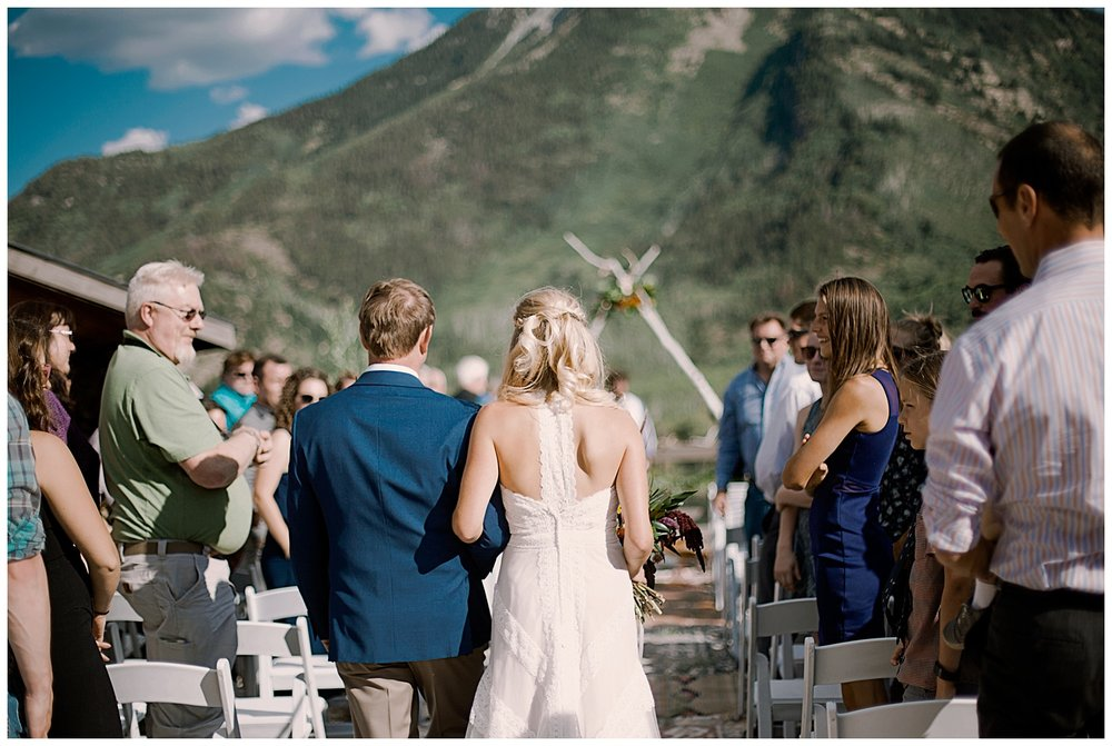 bride walking down the aisle, wedding procession, outdoor colorado wedding ceremony, adventurous colorado wedding photographer, marble colorado wedding, marble lodge wedding