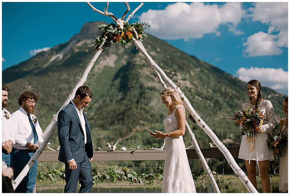 bride and groom saying their vows, marble lodge wedding, marble colorado wedding, maroon bells wilderness wedding, adventurous colorado wedding photographer
