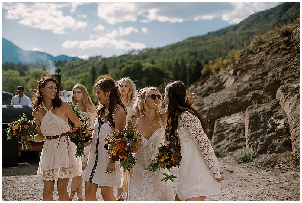 bride and bridesmaids dancing, cocktail hour, outdoor colorado wedding, marble colorado wedding, marble lodge wedding, adventurous colorado wedding photographer
