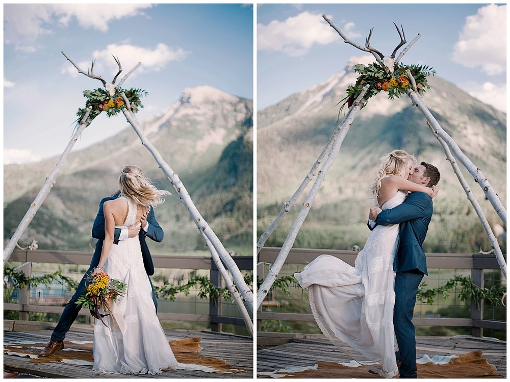 bride and groom, natural wedding arch with florals, outdoor colorado wedding, adventurous colorado wedding photographer, marble colorado wedding, marble lodge wedding