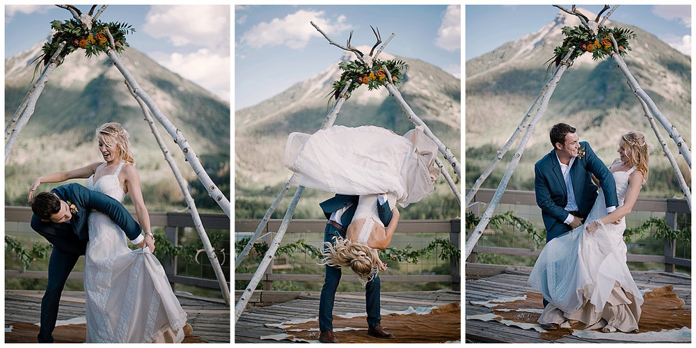 groom flips the bride, outdoor colorado wedding, natural wedding arch with florals, adventurous colorado wedding photographer, marble lodge wedding, marble colorado wedding