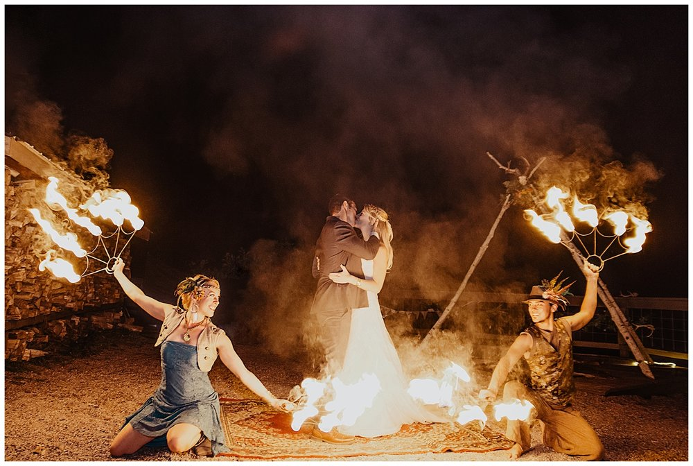 colorado fire dancers, bride and groom kiss, outdoor colorado wedding, marble colorado wedding, marble lodge wedding, adventurous colorado wedding photographer, lumina entertainment