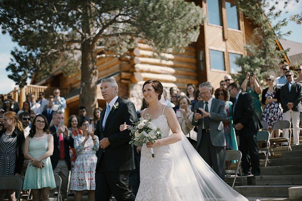 bride walking down the aisle, breckenridge colorado wedding, breckenridge colorado wedding photographer, the church at agape outpost wedding, agape outpost wedding photographer