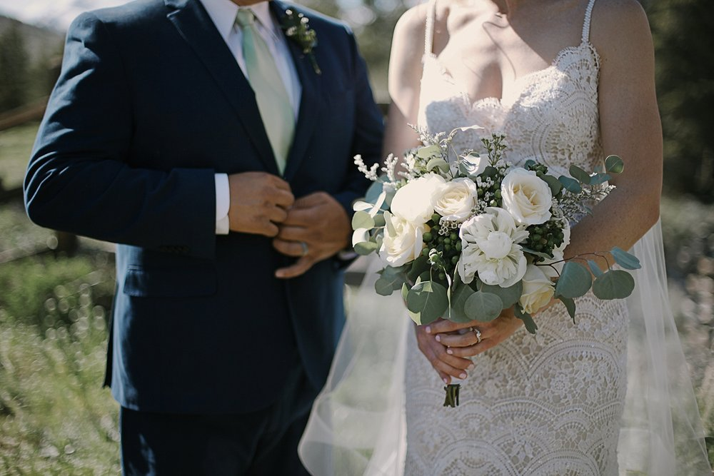 bride and groom at agape outpost, wedding details, breckenridge colorado wedding photographer, breckenridge colorado wedding, agape outpost wedding photographer, the church at agape outpost wedding