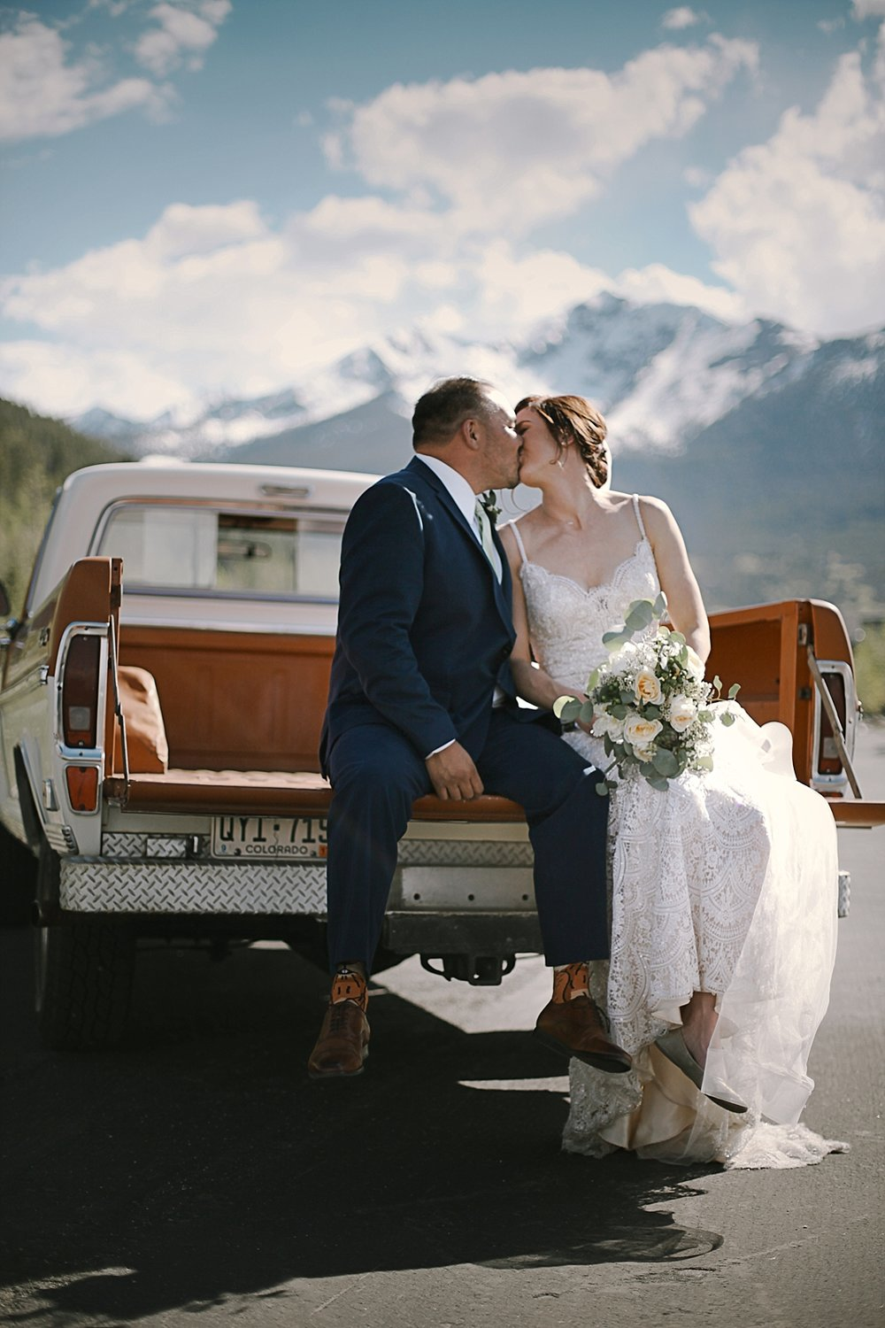 bride and groom in breckenridge colorado, breckenridge colorado wedding, breckenridge colorado wedding photographer, the church at agape outpost wedding, agape outpost wedding photographer