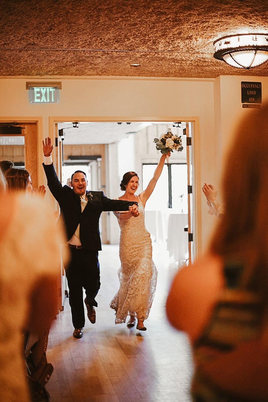 bride and groom entering reception, silverthorne pavillion wedding, silverthorne pavillion wedding photographer, silverthorne colorado wedding photographer