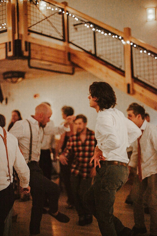 guests dancing wedding reception, silverthorne colorado wedding photographer, silverthorne pavillion wedding, silverthorne pavillion wedding photographer
