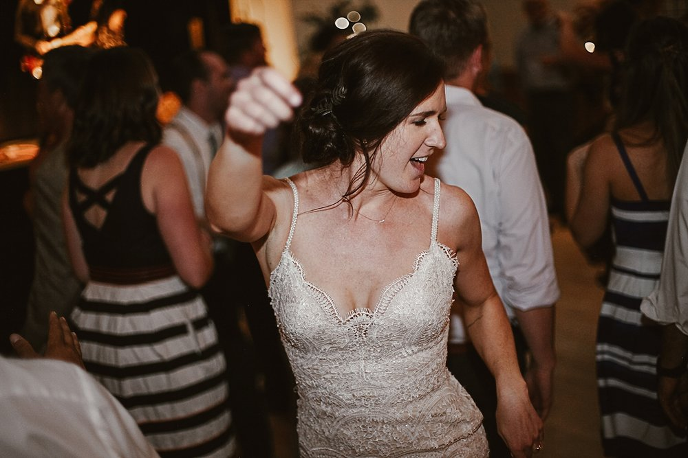 bride dancing, silverthorne pavillion wedding reception, silverthorne pavillion wedding, silverthorne pavillion wedding photographer, silverthorne colorado wedding