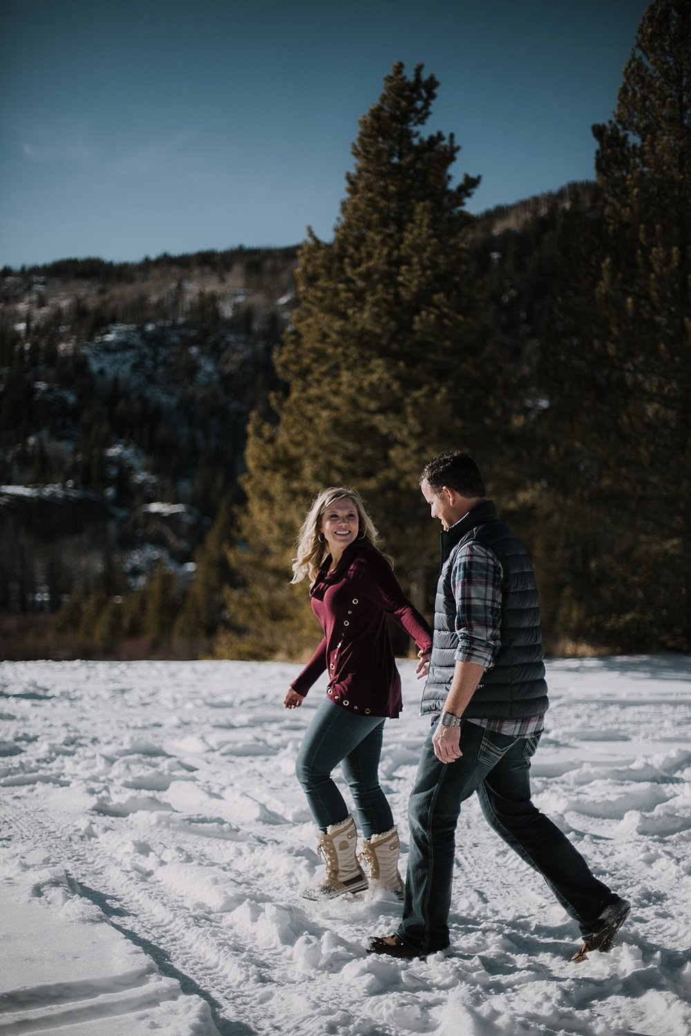 couple walking together, colorado adventure session, colorado engagement session, colorado wedding photographer, leadville wedding photographer, red cliff wedding photographer