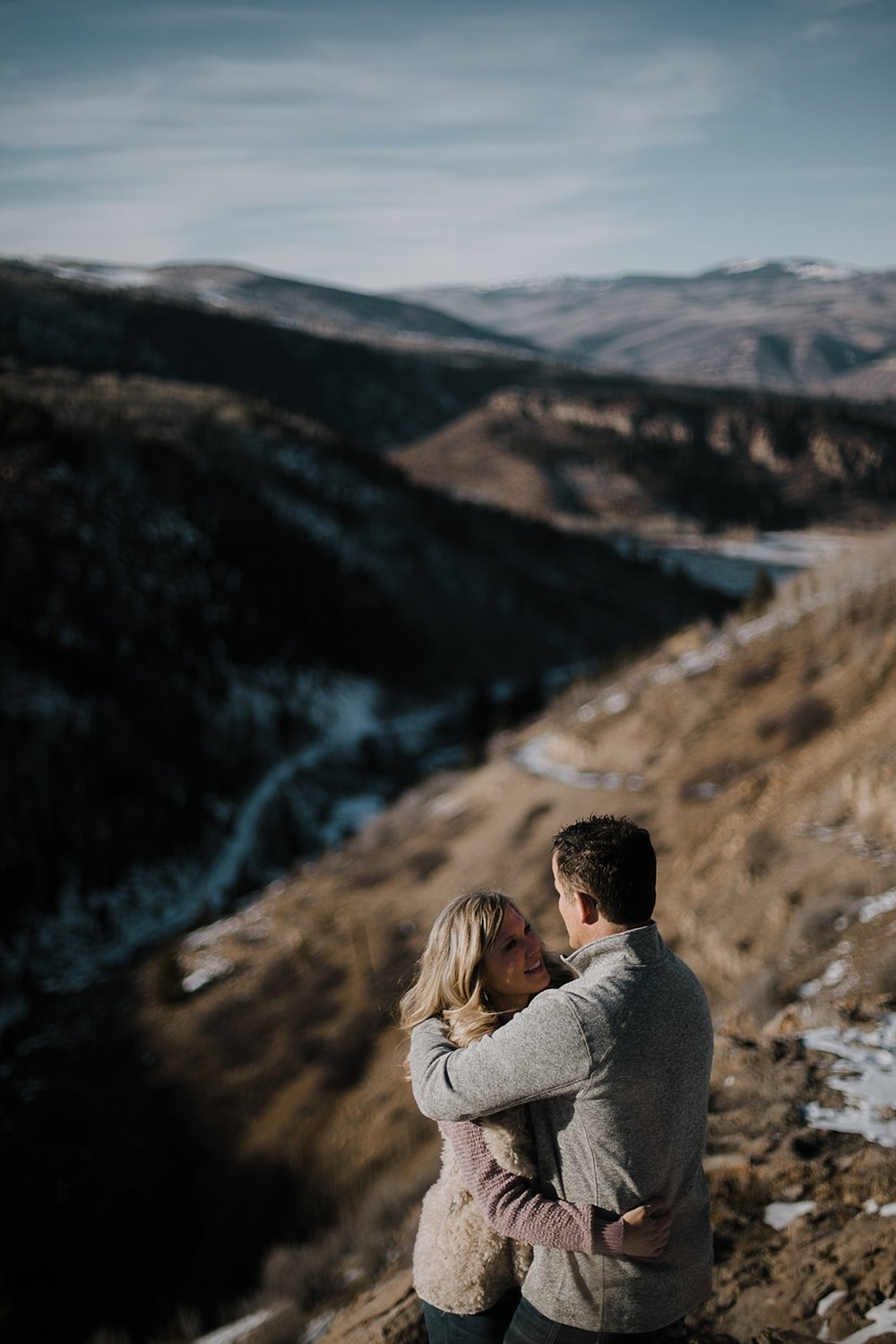 couple on cliffside, adventurous colorado engagements, colorado wedding photographer, adventurous colorado wedding photographer, red cliff wedding photographer, leadville wedding photographer