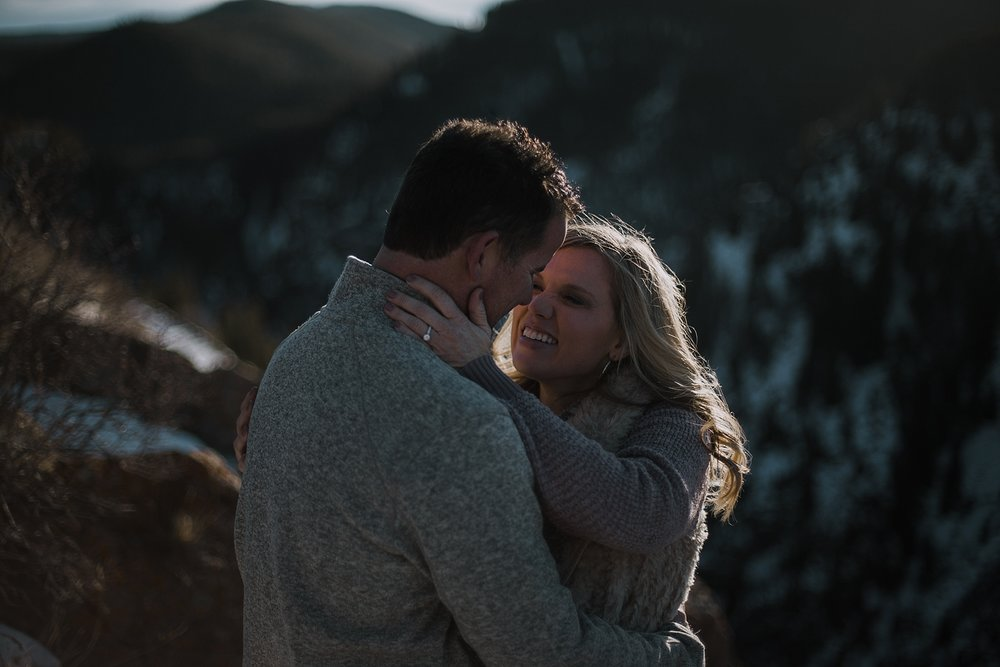 couple on cliffside, hiking photographer, hiking engagements, colorado wedding photographer, leadville wedding photographer, red cliff wedding photographer