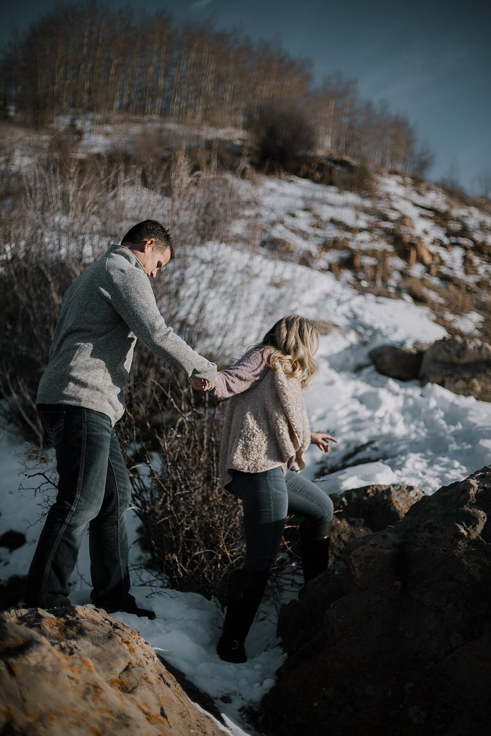 couple hiking, hiking engagements, adventurous colorado engagements, colorado wedding photographer, red cliff wedding photographer, leadville wedding photographer