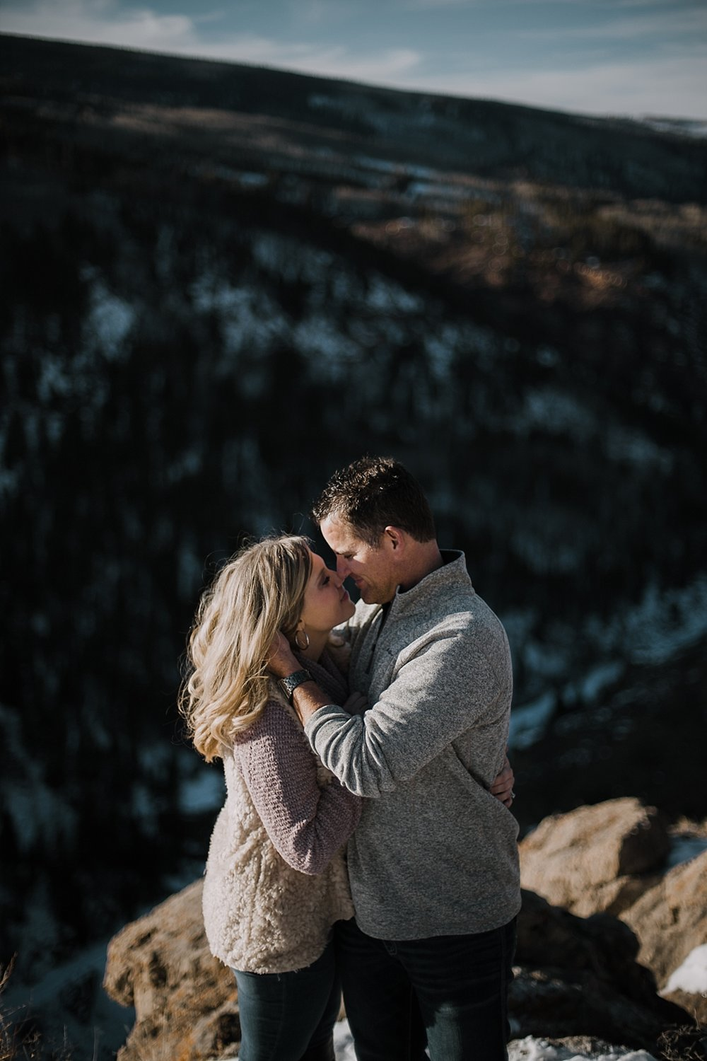 couple on cliffside, adventurous colorado wedding photographer, adventurous hiking engagements, hiking engagements, red cliff wedding photographer, leadville wedding photographer