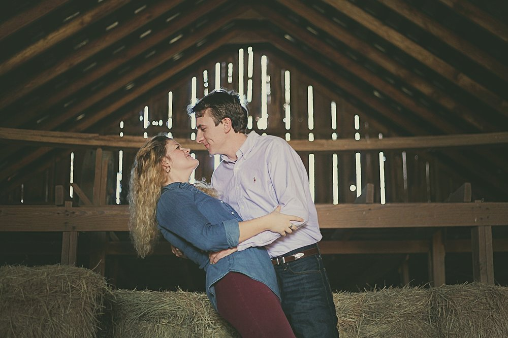 couple in barn, western oklahoma engagements, western oklahoma wedding photographer, oklahoma wedding photographer, thomas oklahoma wedding photographer, weatherford oklahoma wedding photographer