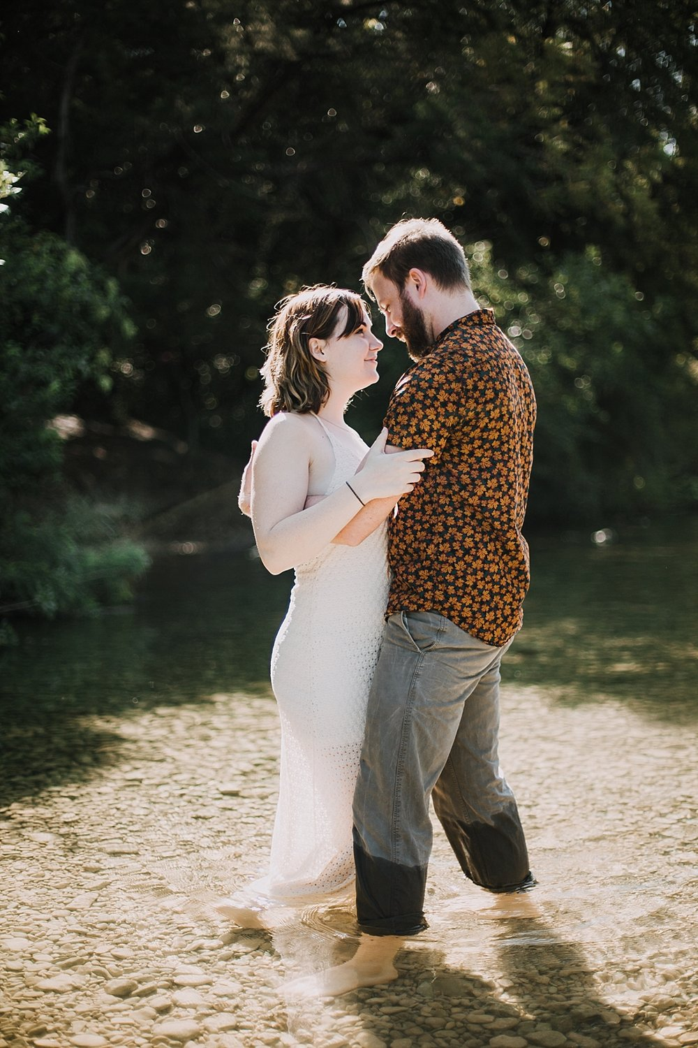 couple wading in the green belt, austin texas wedding photographer, the alexander at creek road wedding photographer, south africa wedding photographer, paris france wedding photographer