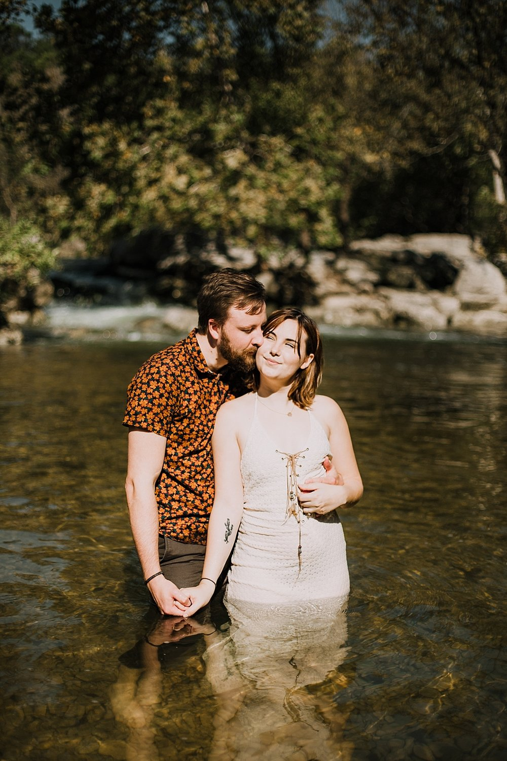 couple swimming in the green belt, austin texas wedding photographer, the alexander at creek road wedding photographer, south africa wedding photographer, paris france wedding photographer