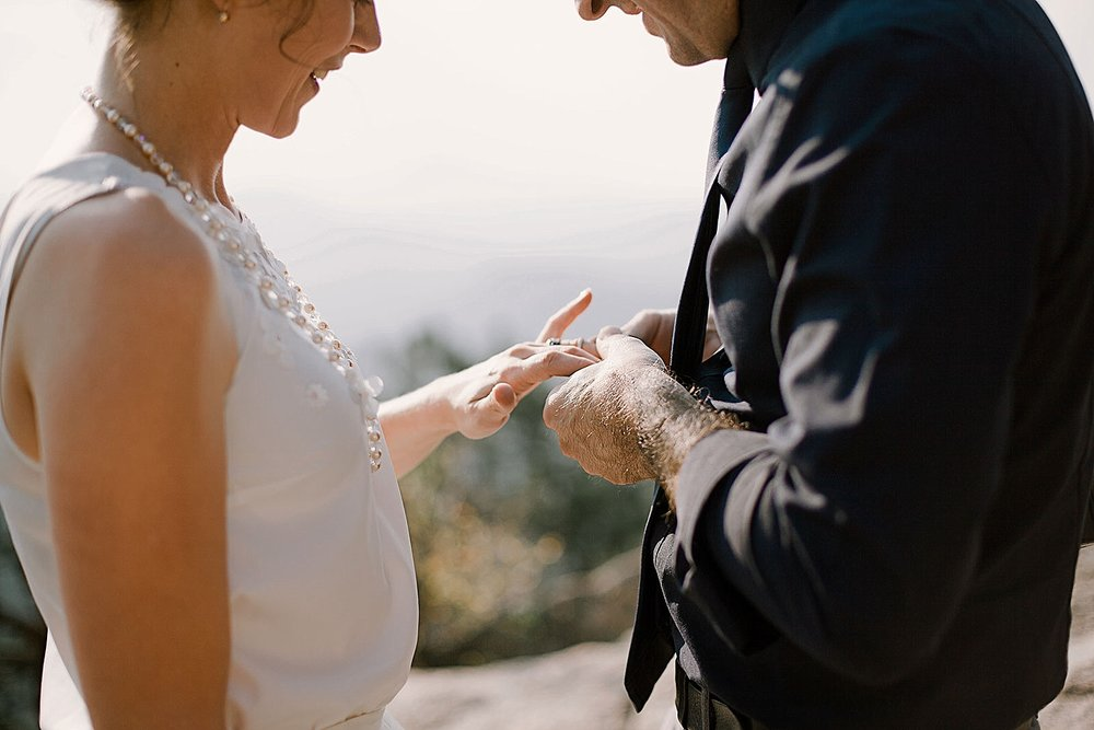 couple exchanging rings, elopement ceremony, intimate elopement, intimate colorado elopement, boulder colorado elopement photographer, nederland elopement photographer, self solemnizing elopement